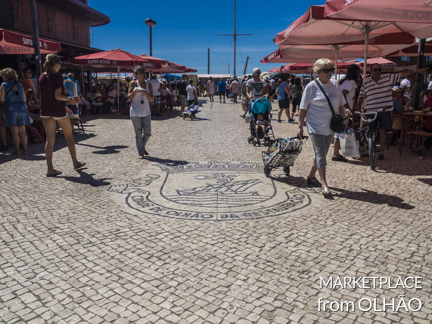 Wide market of typical fruit and fresh fish in Olhão