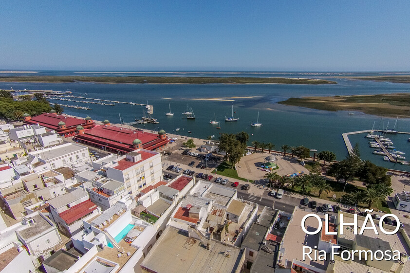 View of the Ria Formosa and the Cubist town of Olhão