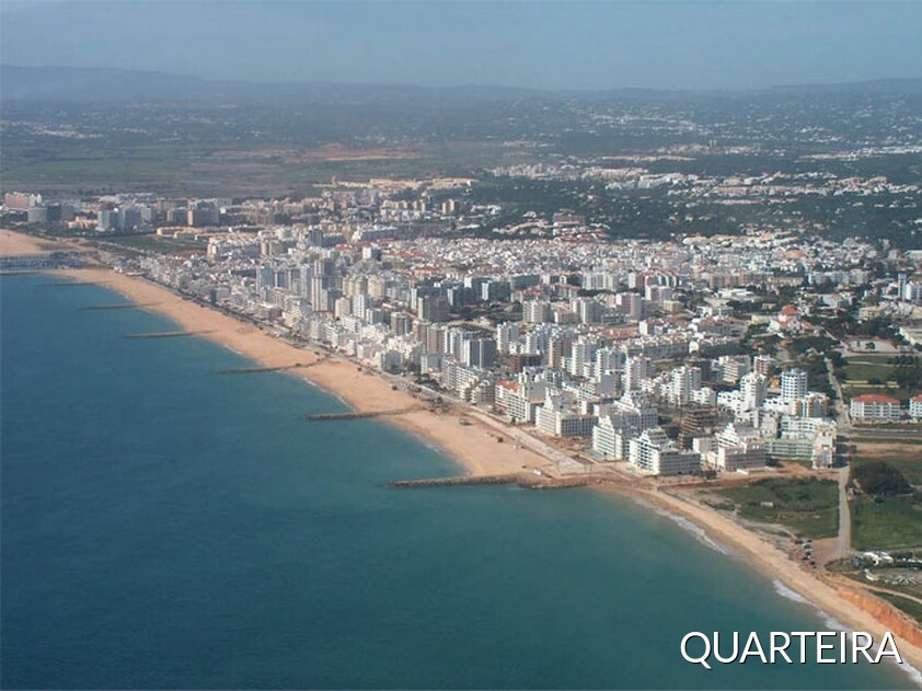 Cityscape of Quarteira, seafront promenade, beach and Vilamoura Incidental